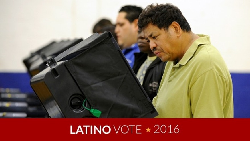 LAS VEGAS, NV - NOVEMBER 06:  Antonio Escober casts his ballot at the polling station at John Fremont Middle School on November 6, 2012 in Las Vegas, Nevada. Voting is underway in the battleground state of Nevada as President Barack Obama and Republican nominee former Massachusetts Gov. Mitt Romney remain in a virtual tie in the national polls. (Photo by David Becker/Getty Images)