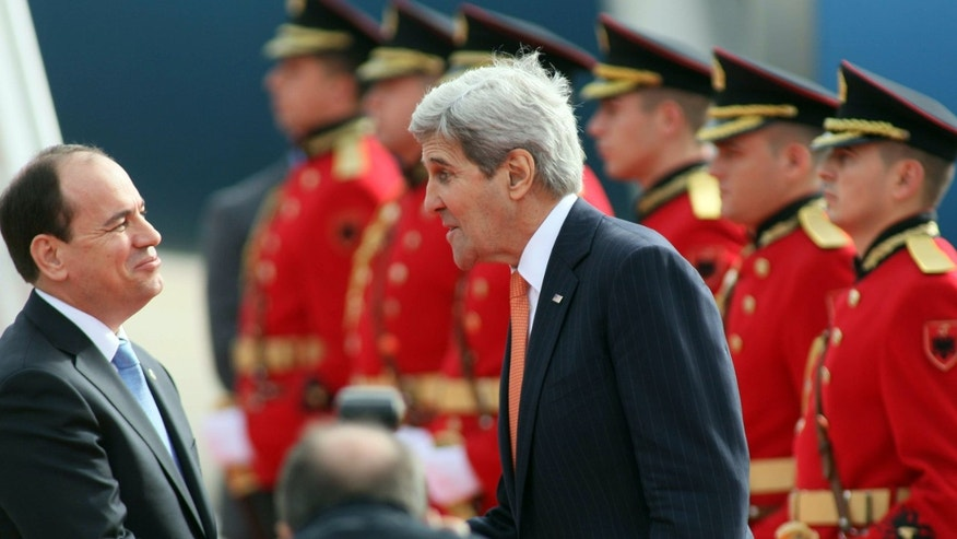 Feb. 14, 2016: U.S Secretary of State John Kerry, right, meets with host Albanian President Bujar Nishani after landing at the International Airport Mother Teresa, Tirana.