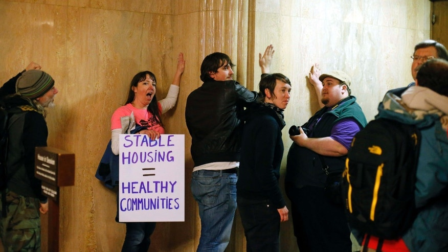 Feb. 18, 2016: Protesters pound on the walls outside of the House Chamber in the Capitol Building, in Salem , Ore.