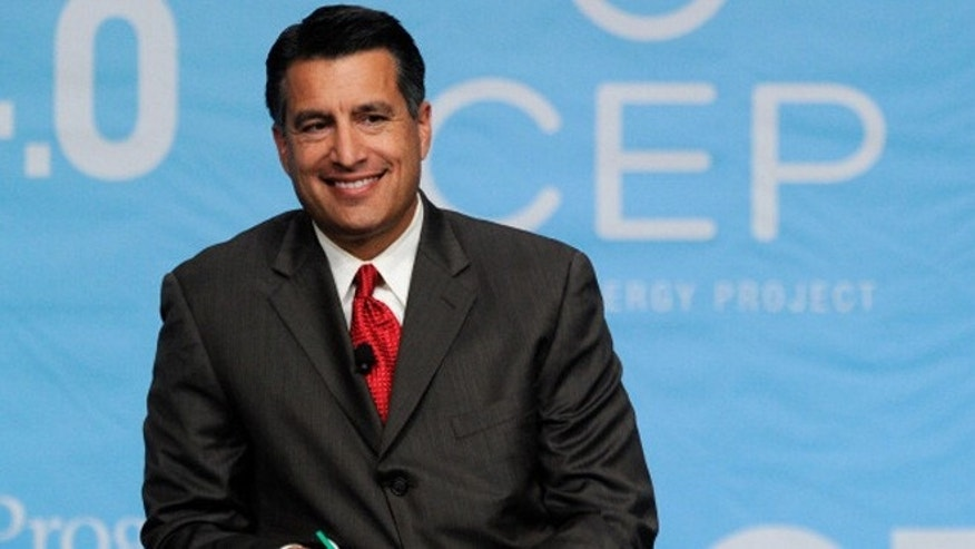LAS VEGAS, NV - AUGUST 30:  Nevada Gov. Brian Sandoval smiles during the National Clean Energy Summit 4.0 at the Aria Resort & Casino at CityCenter August 30, 2011 in Las Vegas, Nevada. Political and economic leaders are attending the summit to discuss a domestic policy agenda to advance alternative energy for the country's future.  (Photo by Ethan Miller/Getty Images)