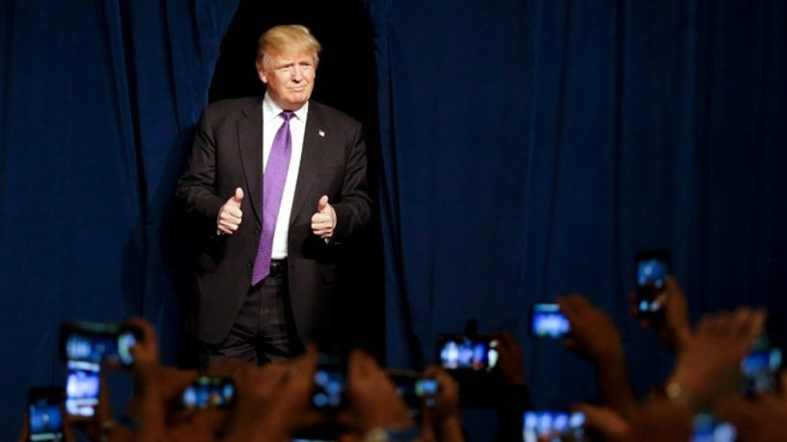 Donald Trump arrives for a caucus night rally Tuesday, Feb. 23, 2016, in Las Vegas.