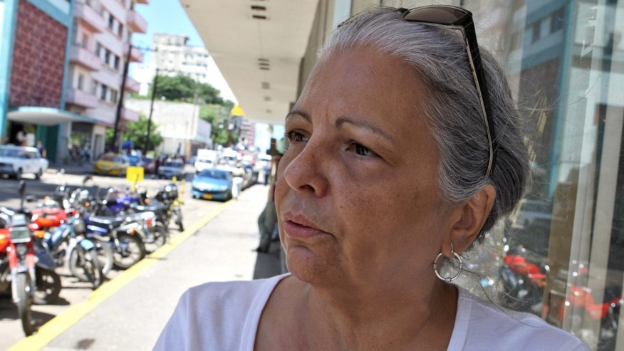 Cuban opposition leader Marta Beatriz Roque is seen 27 September 2007 in front of the Justice Ministry in Havana, where she and other relatives of political prisoners delivered a letter dennouncing their conditions of imprisonment.  AFP PHOTO/ADALBERTO ROQUE (Photo credit should read ADALBERTO ROQUE/AFP/Getty Images)