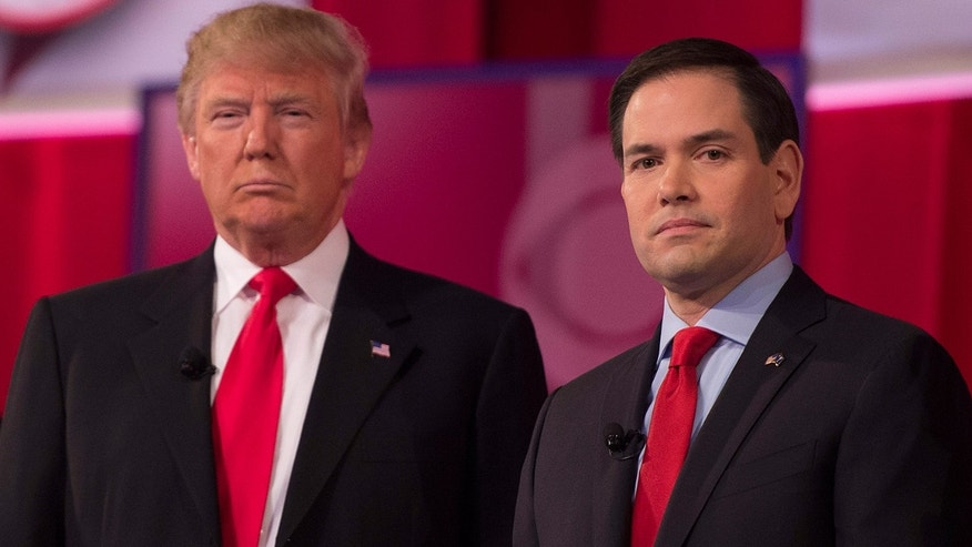 Republican presidential candidates Donald Trump (L) and Marco Rubio stand on stage during the CBS News Republican Presidential Debate in Greenville, South Carolina, February 13, 2016. / AFP / JIM WATSON (Photo credit should read JIM WATSON/AFP/Getty Images)