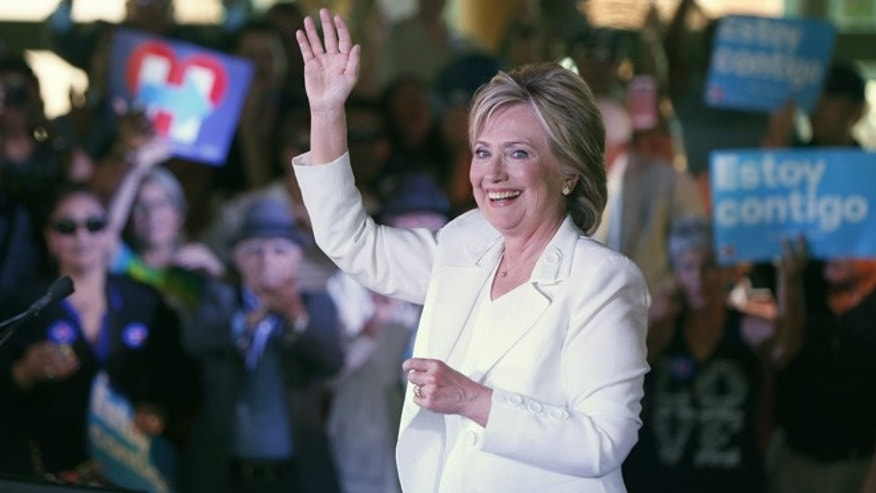 "SAN ANTONIO, TX - OCTOBER 15:  Democratic U.S. presidential hopeful Hillary Clinton acknowledges supporters at a ""Latinos for Hillary"" grassroots event October 15, 2015 in San Antonio, Texas. The event was part of the campaign's ongoing effort to build an organization outside of the four early states and work hard for every vote.  (Photo by Erich Schlegel/Getty Images)"