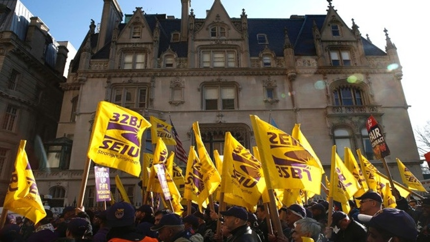 April 2, 2014: Members of the Service Employees International Union (SEIU) march during a protest in support of a new contract for apartment building workers in New York City.