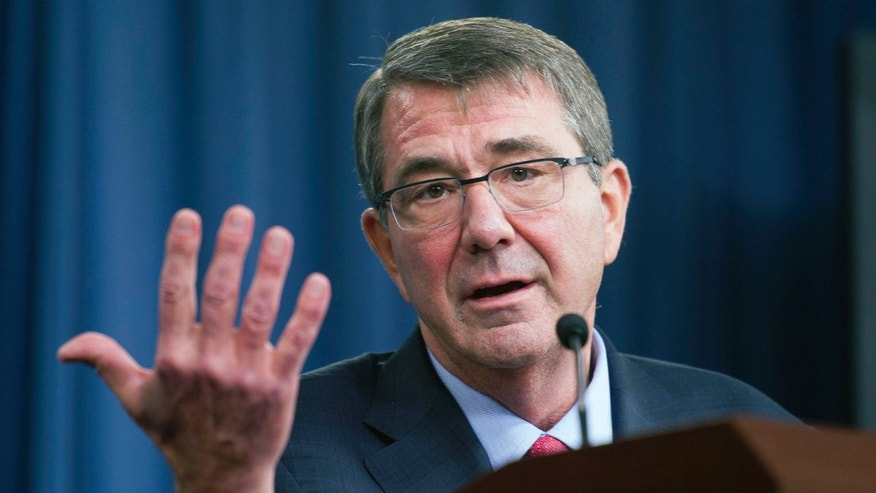 FILE - In this Jan. 28, 2016 file photo, Defense Secretary Ash Carter gestures during a news conference at the Pentagon.