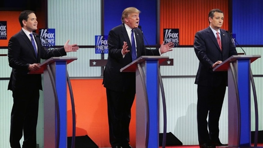 DETROIT, MI - MARCH 03:  Republican presidential candidates (Lto R) Sen. Marco Rubio (R-FL), Donald Trump and Sen. Ted Cruz (R-TX) participate in a debate sponsored by Fox News at the Fox Theatre on March 3, 2016 in Detroit, Michigan. Voters in Michigan will go to the polls March 8 for the State's primary.  (Photo by Chip Somodevilla/Getty Images)
