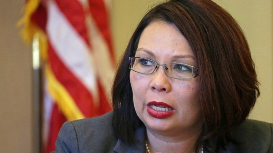 July 31, 2015 file photo: U.S. Rep. Tammy Duckworth D-Ill., appears before the Chicago City Council's finance committee.
