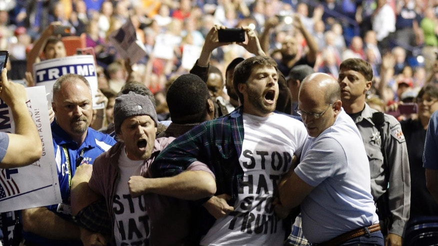 Protesters are removed from a Donald Trump rally in Fayetteville, N.C.