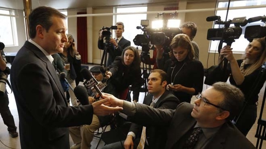 Republican presidential candidate, Sen. Ted Cruz, R-Texas, talks with reporters before a rally at the historic Coronado Performing Arts Center Monday, March 14, 2016, in Rockford, Ill. (AP Photo/Charles Rex Arbogast)