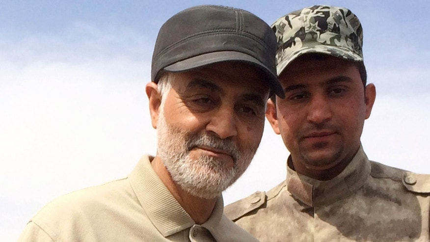 March 8, 2015: Iranian Revolutionary Guard Commander Qassem Soleimani (L) stands at the frontline during offensive operations against Islamic State militants in the town of Tal Ksaiba in Salahuddin province.