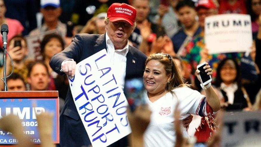 Donald Trump and Betty Rivas during a campaign rally Saturday, March 19, 2016, in Tucson, Ariz.