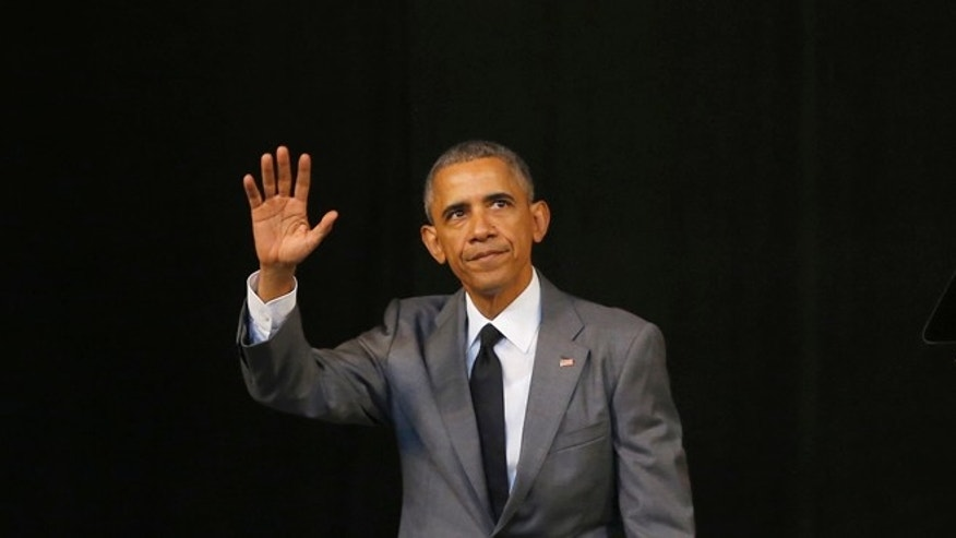 "United States President Barack Obama waves after speaking at the Grand Theater of Havana, Cuba, Tuesday, March 22, 2016.  Obama started his speech by pledging that the U.S. will ""do whatever is necessary"" to help Belgium bring to justice those who carried out today's terrorist attacks and went on to urge Cubans to look to the future with hope, casting his historic visit as a moment to ""bury the last remnants of the Cold War in the Americas."" (AP Photo/Desmond Boylan)"