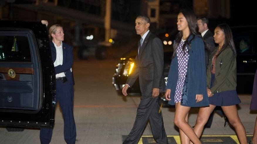 President Obama and family arrive at the international Buenos Aires airport, Argentina.