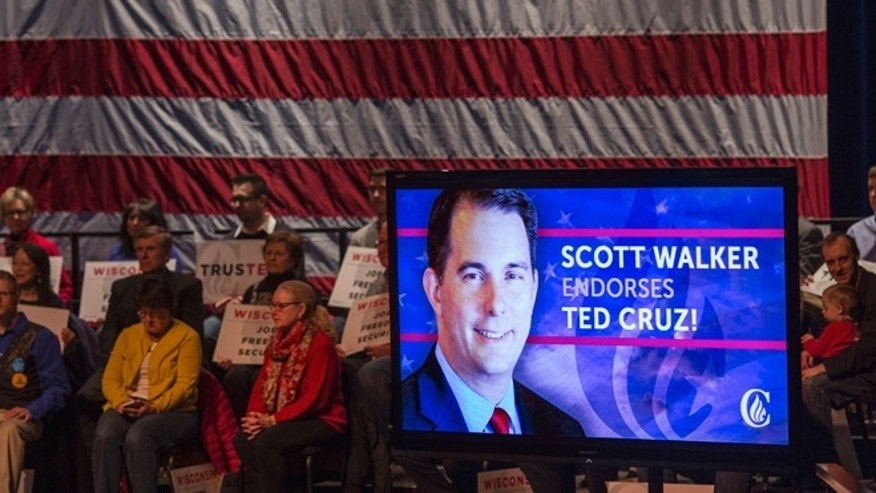 A live radio feed of Wisconsin Gov. Scott Walker's endorsement of Republican presidential candidate, Sen. Ted Cruz, R-Texas is played before a Cruz rally at the Sharon Lynne Wilson Center for the Arts, Tuesday, March 29, 2016, in Brookfield. (AP Photo/Tom Lynn)