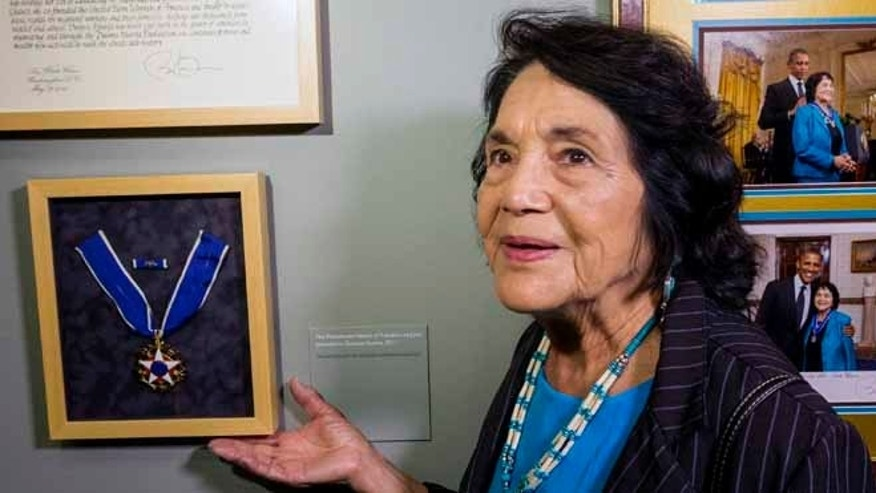 "Dolores Huerta, co-founder of United Farms Workers, shows her Presidential Medal of Freedom Award at La Plaza de la Cultura y Artes museum in Los Angeles. The civil rights icon says she holds no ill feelings toward actress Rosario Dawson over her ""open letter"" criticizing Huerta for supporting Hillary Clinton."