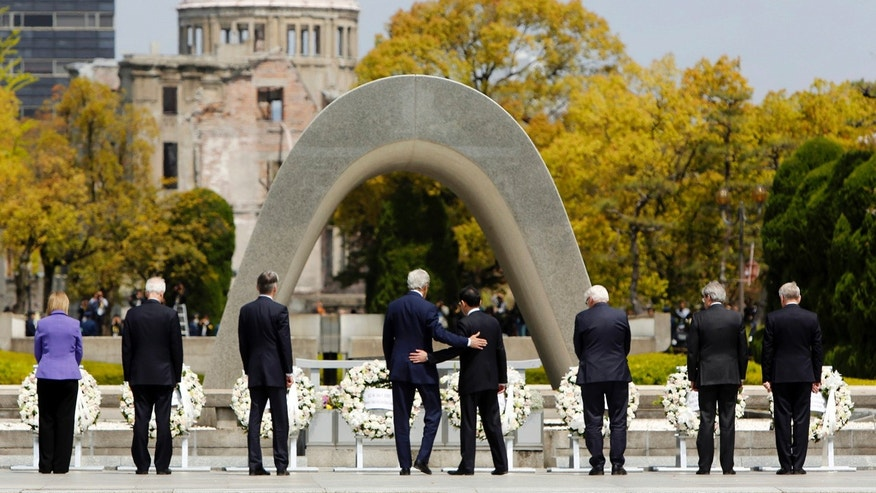 April 11, 2016: U.S. Secretary of State John Kerry, center left, puts his arm around Japan's Foreign Minister Fumio Kishida, center right, after they and fellow G7 foreign ministers laid wreaths at the cenotaph at Hiroshima Peace Memorial Park in Hiroshima, Japan.