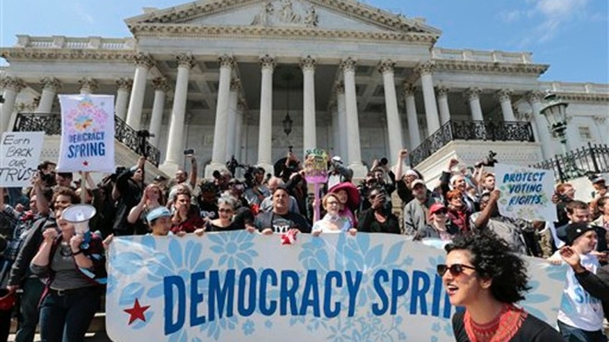 Alejandra Pablos of Arizona, lower right, leads a chant as voting rights reform demonstrators stage a sit-in at the Capitol in Washington, Monday, April 11, 2016, urging lawmakers to take money out of the political process.  (AP Photo/J. Scott Applewhite)
