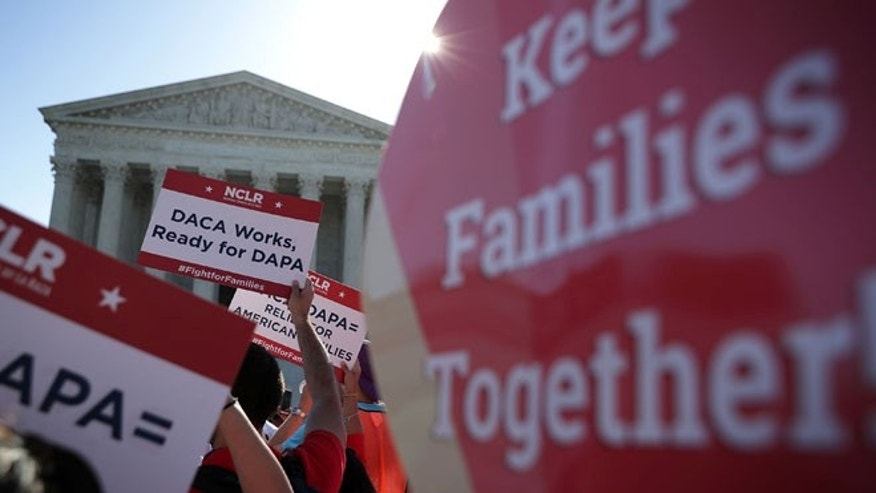 Pro-immigration activists gather in front of the U.S. Supreme Court on April 18, 2016 in Washington, DC.