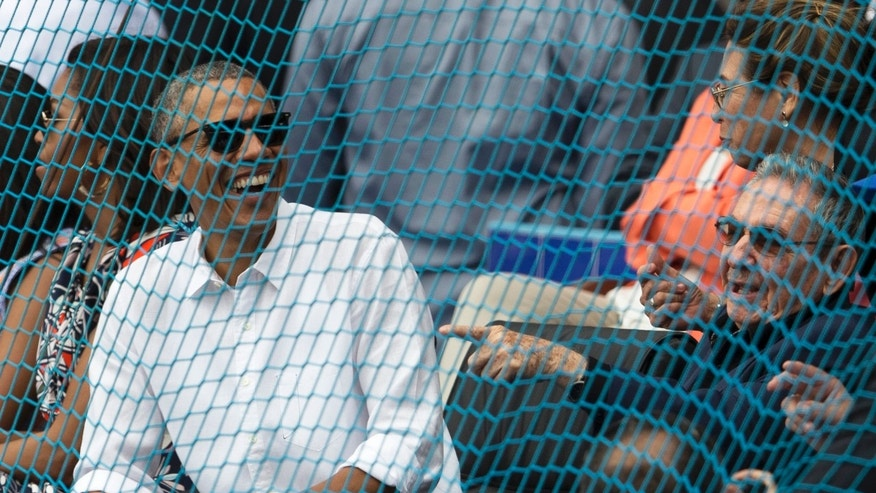 Cuban President Raul Castro, right,  and U.S. President Barack Obama attend a baseball match between the Tampa Bay Rays and  the Cuban national baseball team in Havana, Cuba, Tuesday, March 22, 2016. The crowd roared as Obama and Cuban President Raul Castro entered the stadium and walked toward their seats in the VIP section behind home plate. It's the first game featuring an MLB team in Cuba since the Baltimore Orioles played in the country in 1999. (Ismael Francisco/Cubadebate via AP)