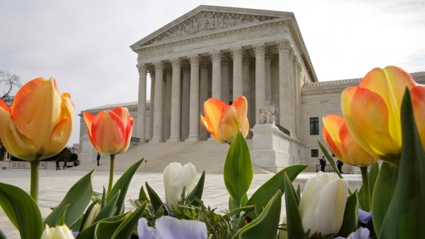 "The Supreme Court is seen in Washington, Monday, April 4, 2016, after justices ruled in a case involving the constitutional principle of ""one person, one vote"" and unanimously upheld a Texas law that counts everyone, not just eligible voters, in deciding how to draw legislative districts.  (AP Photo/J. Scott Applewhite)"