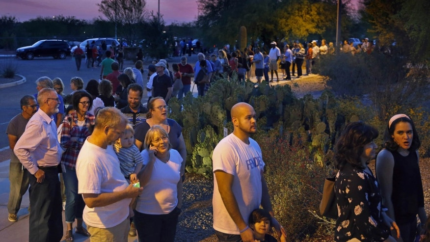 People wait in line to vote in the primary Tuesday, March 22, 2016, in Chandler, Ariz. A document obtained from the Maricopa County Recorder's Office shows that five polling places in metro Phoenix still had voters in line after midnight during Arizona's botched presidential primary two weeks ago, including one location where the final ballot was cast at nearly 1 a.m., according to county records. (David Kadlubowski/The Arizona Republic via AP)  MARICOPA COUNTY OUT; MAGS OUT; NO SALES; MANDATORY CREDIT