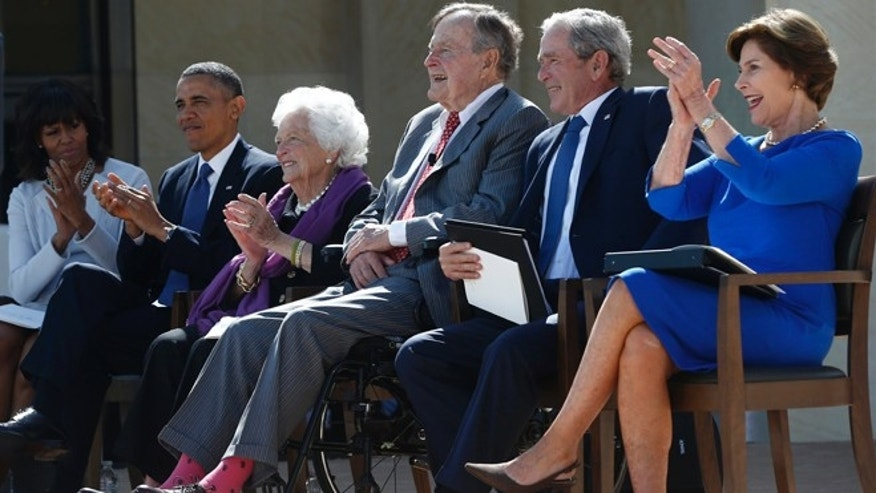 April 25, 2013: President Barack Obama, first lady Michelle Obama, former first lady Barbara Bush, former Presidents George H.W. Bush, George W. Bush, and former first lady Laura Bush take part in the dedication of the George W. Bush presidential library on the campus of Southern Methodist University in Dallas.
