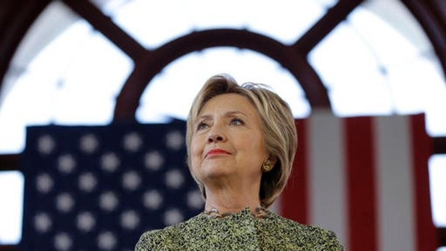 Democratic presidential candidate Hillary Clinton listens to a speaker at a rally in the Staten Island borough of New York, Sunday, April 17, 2016. (AP Photo/Seth Wenig)