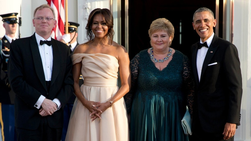 May 13, 2016: President Barack Obama and first lady Michelle Obama stand with Norwegian Prime Minister Erna Solberg and her husband Sindre Finnes as they arrive at the North Portico of the White House in Washington.