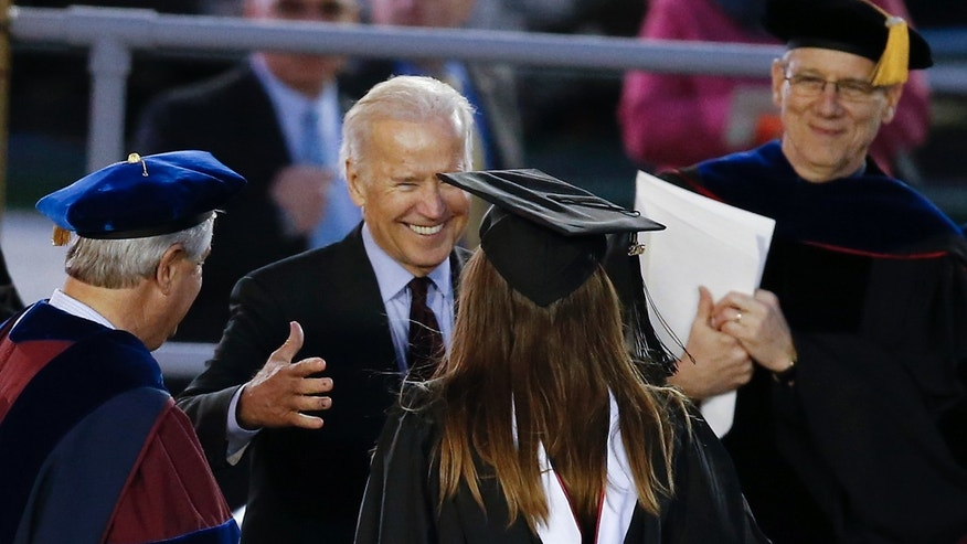 May 15, 2016: Vice President Joe Biden embraces his granddaughter Naomi Biden at her graduation ceremony at the University of Pennsylvania in Philadelphia.