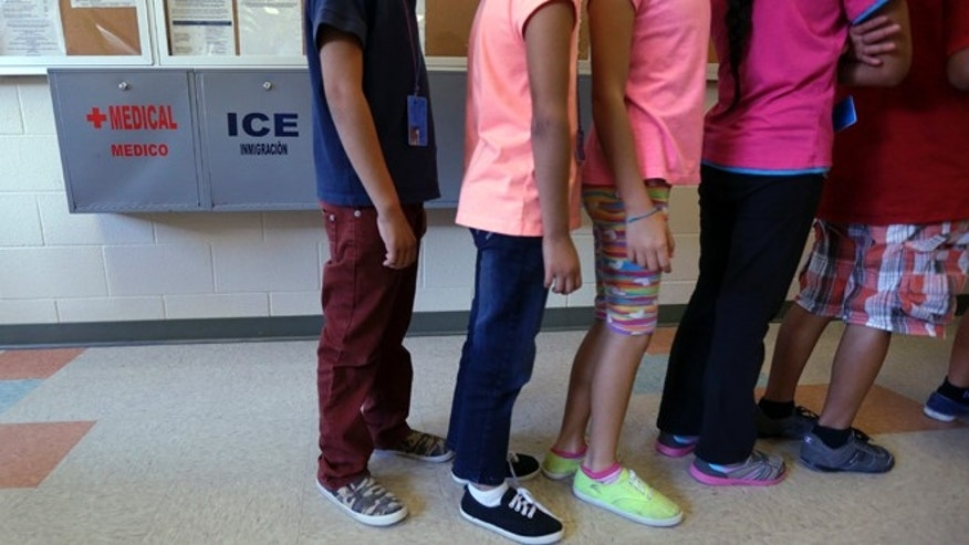 Immigrant children line up in the cafeteria at the Karnes County Residential Center in Karnes City, Texas.