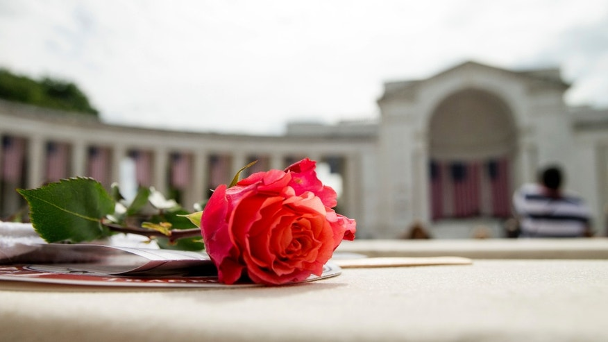 May 30, 2016: A rose is visible on a seat before President Barack Obama speaks at the Memorial Amphitheater of Arlington National Cemetery, in Arlington, Va., during a Memorial Day ceremony.