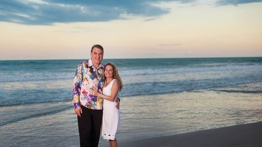 May 29, 2016: This photo provided by Alan Grayson for Senate shows Rep. Alan Grayson, left, and his wife Dr. Dena Grayson after a wedding ceremony with family and friends in attendance at Melbourne Beach, Florida.