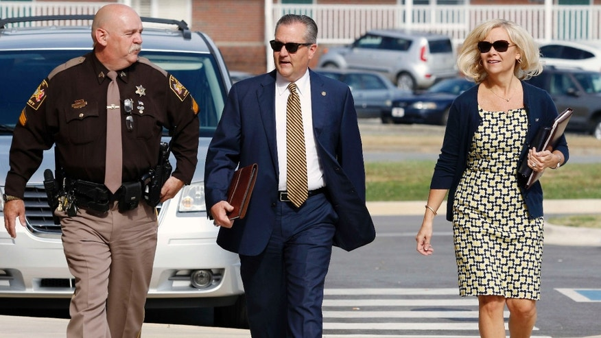 Mike , center, and Susan Hubbard walk to the Lee County Justice Center for closing arguments in the Alabama House Speaker's Trial on Friday, June 10, 2016, in Opelika, Ala.