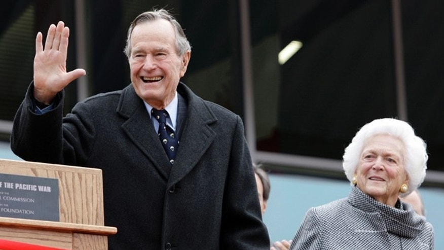 FILE - In this Dec. 7, 2009 file photo, former President George H.W. Bush and former first lady Barbara Bush arrive for a ceremony to dedicate an expanded gallery that carries his name at the National Museum of the Pacific War, in Fredericksburg, Texas. (AP Photo/Eric Gay, File)