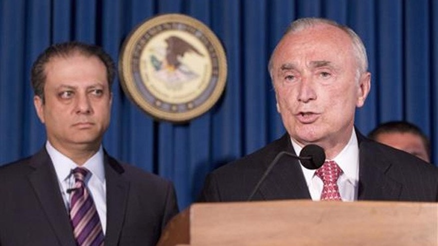 U. S. Attorney Preet Bharara, left, listens as New York City Police Commissioner William Bratton discusses the arrest of four people in connection with New York City's ongoing corruption probe, Monday, June 20, 2016, in New York.