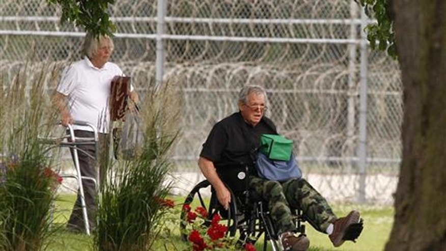 June 22, 2016: Former Speaker of the House Dennis Hastert, right, reports to the Federal Medical Center in Rochester, Minn.