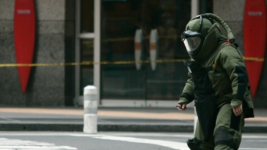 July 10, 2007: A suspicious bag is emptied by a police officer after the area was closed off in New York.