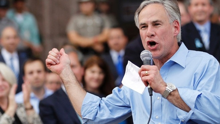 Texas Attorney General Greg Abbott speaks during an anti-abortion rally at the State Capitol in Austin, Texas, July 8, 2013.  The political battle in Texas over proposed restrictions on abortion resumes on Monday with a rally by abortion opponents and a public hearing in the state Senate, where Democrat Wendy Davis staged a filibuster last month to stall the Republican-backed measure.  REUTERS/Mike Stone (UNITED STATES) - RTX11HAF