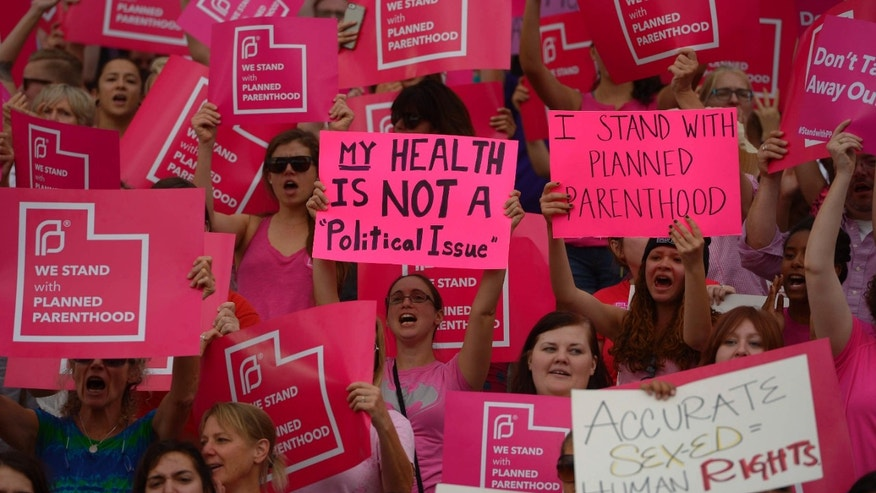 FILE - This Aug. 25, 2015, file photo, Planned Parenthood Action Council holds a community rally at the state Capitol, in Salt Lake City.