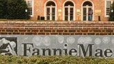 A stands outside Fannie Mae headquarters in Washington February 21, 2014. Fannie Mae said on Friday it would soon send the U.S. Treasury $7.2 billion, a profit-related dividend that makes taxpayers whole for the 2008 bailout of the mortgage-finance giant and its sibling company Freddie Mac.