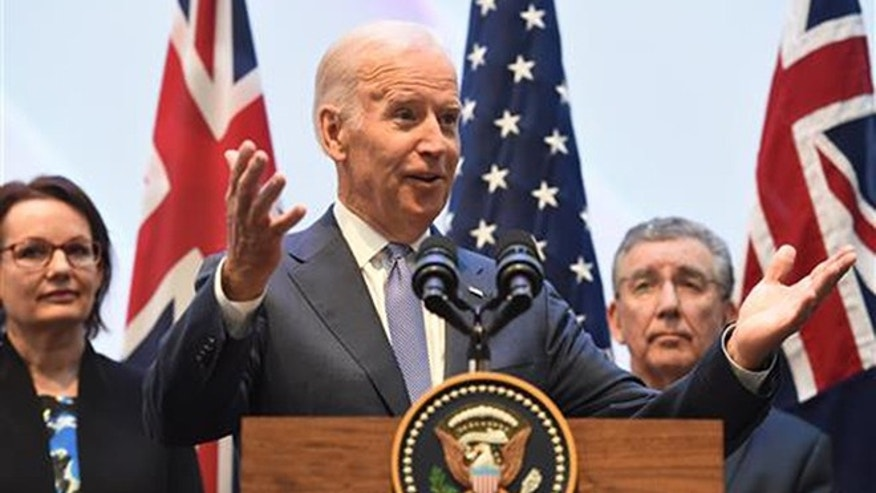 U.S. Vice President Joe Biden, center, speaks to guests with Health Minister Susan Ley, left, and Professor Jim Bishop after a tour of the Victorian Comprehensive Cancer Centre in Melbourne, Sunday, July 17, 2016. Biden attended the opening of Victoria's $1 billion Comprehensive Cancer Centre while on his four day visit to Australia.(Tracey Nearmy/Pool Photo via AP)