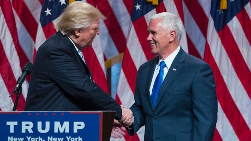 Republican presidential candidate Donald Trump, right, introduces Gov. Mike Pence, R-Ind., during a campaign event to announce Pence as the vice presidential running mate on, Saturday, July 16, 2016, in New York. (AP Photo/Evan Vucci)