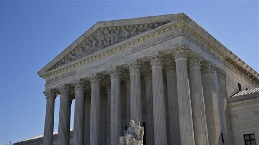 Administration asks new immigration review with 9 justices