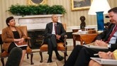 President Barack Obama, center, with Attorney General Loretta Lynch, left, and FBI Director James Comey, right, sit during their meeting in the Oval Office of the White House in Washington, Tuesday, July 19, 2016. (AP Photo/Pablo Martinez Monsivais)