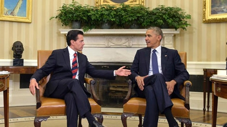 President Barack Obama, right, meets with Mexican President Enrique Pena Nieto, left, in the Oval Office of the White House in Washington, Friday. ( (AP Photo/Susan Walsh)