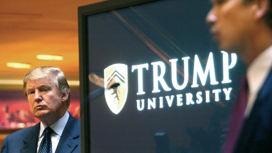 FILE- In this May 23, 2005 file photo, real estate mogul and Reality TV star Donald Trump, left, listens as Michael Sexton introduces him at a news conference in New York where he announced the establishment of Trump University.