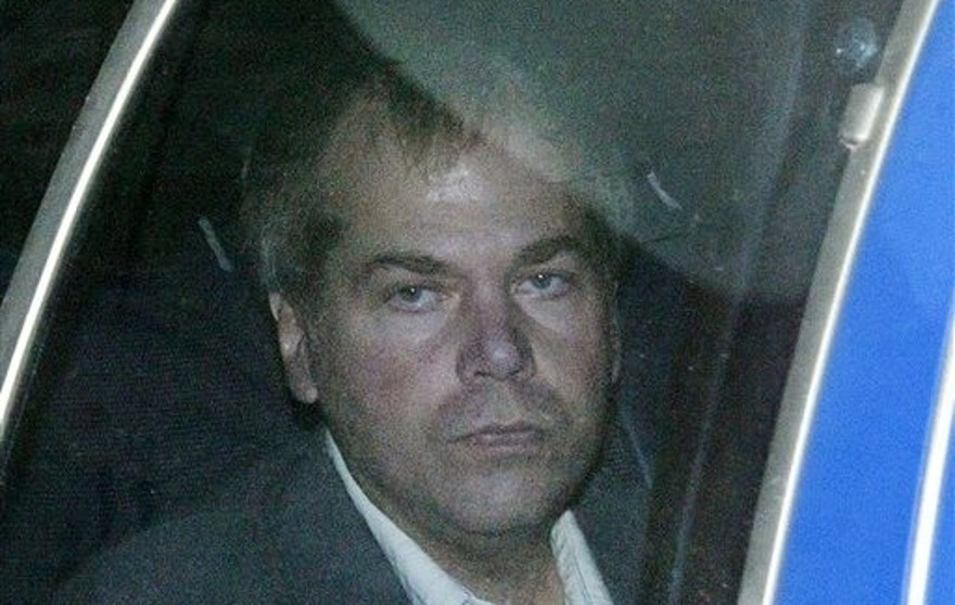 FILE - In this Nov. 18, 2003 file photo, John Hinckley Jr. arrives at U.S. District Court in Washington. The last man to shoot an American president now spends most of the year in a house overlooking the 13th hole of a golf course in a gated community. He takes long walks along tree-lined paths, plays guitar and paints, grabs fast food at Wendy's. He drives around town in a silver Toyota Avalon, a car that wouldn't attract a second glance. Often, as if to avoid detection, he puts on a hat or visor before going out. (AP Photo/Evan Vucci, File)