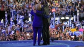 President Barack Obama, right, and Democratic presidential candidate Hillary Clinton, left, wave to the crowd following Obama's speech at the Democratic National Convention in Philadelphia, Wednesday, July 27, 2016. (AP Photo/Susan Walsh)