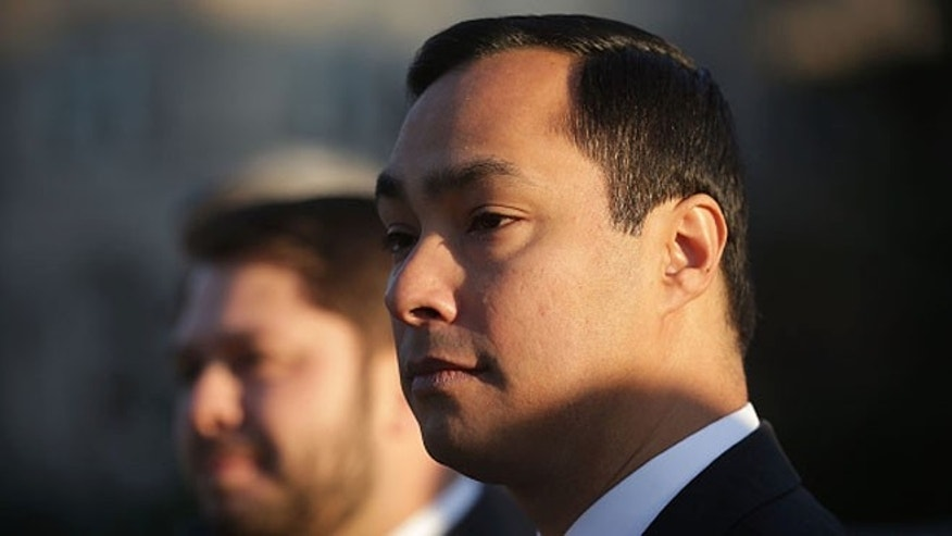 "WASHINGTON, DC - DECEMBER 08:  U.S. Rep. Joaquin Castro (D-TX) (R) listens during a news conference in front of the Supreme Court December 8, 2015 in Washington, DC. The Congressional Hispanic Caucus held the news conference on the day the Supreme Court hears oral arguments on Evenwel v. Abbott, ""on whether voting districts should continue to be drawn by using census population data, which include noncitizen immigrants, or whether the system should be changed to count only citizens eligible to vote, as conservative challengers are seeking.""  (Photo by Alex Wong/Getty Images)"